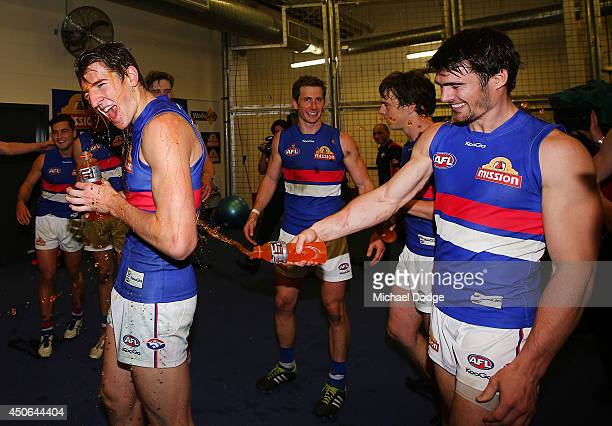 Marcus Bontempelli of the Bulldogs gets doused with Gatorade by Easton Wood of the Bulldogs as they celebrate their win during the round 13 AFL match...