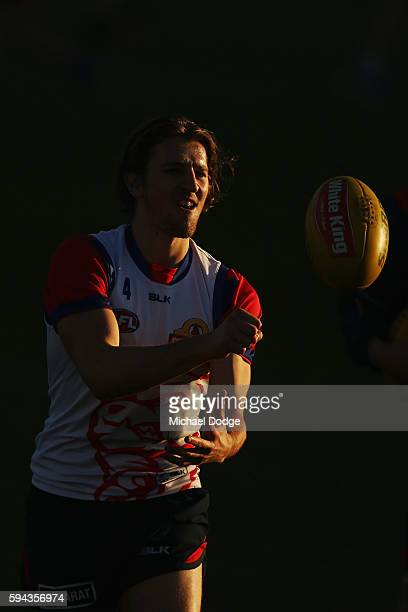 Marcus Bontempelli of the Bulldogs handballs during a Melbourne City FC ALeague training session ahead of their FFA Cup round of 16 match at La Trobe...