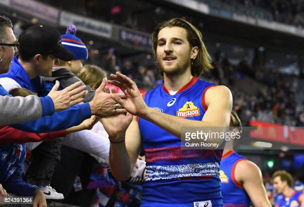 Marcus Bontempelli of the Bulldogs high fives fans after winning the round 19 AFL match between the Western Bulldogs and the Essendon Bombers at...