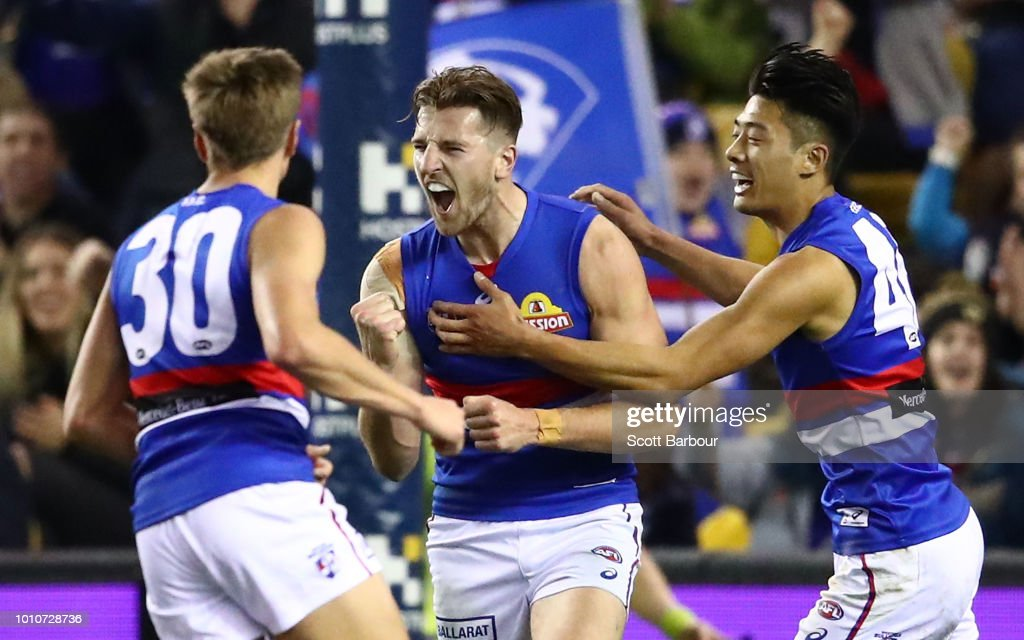 Marcus Bontempelli of the Bulldogs is congratulated by Lin Jong of the Bulldogs and his teammates after kicking a goal during the round 20 AFL match between the St Kilda Saints and the Western Bulldogs at Etihad Stadium on August 4, 2018 in Melbourne, Australia.