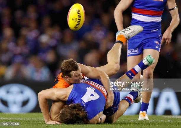 Marcus Bontempelli of the Bulldogs is tackled by Steve Johnson of the Giants during the 2017 AFL round 21 match between the Western Bulldogs and the...