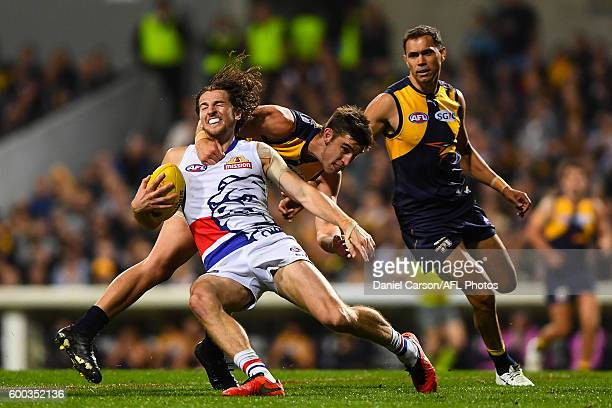 Marcus Bontempelli of the Bulldogs is tackled high by Elliot Yeo of the Eagles during the 2016 AFL Second Elimination Final match between the West...