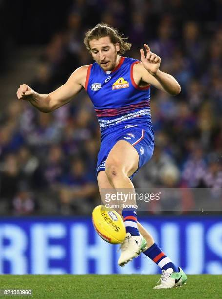 Marcus Bontempelli of the Bulldogs kicks during the round 19 AFL match between the Western Bulldogs and the Essendon Bombers at Etihad Stadium on...