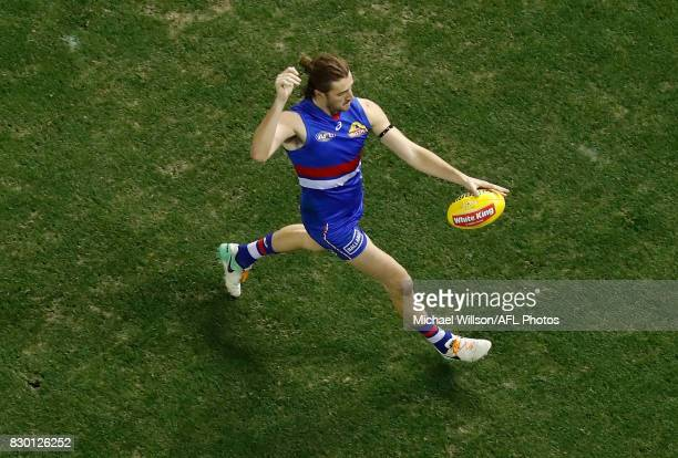 Marcus Bontempelli of the Bulldogs kicks the ball during the 2017 AFL round 21 match between the Western Bulldogs and the GWS Giants at Etihad...