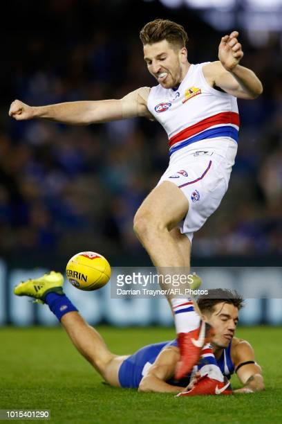 Marcus Bontempelli of the Bulldogs kicks the ball during the round 21 AFL match between the North Melbourne Kangaroos and the Western Bulldogs at...