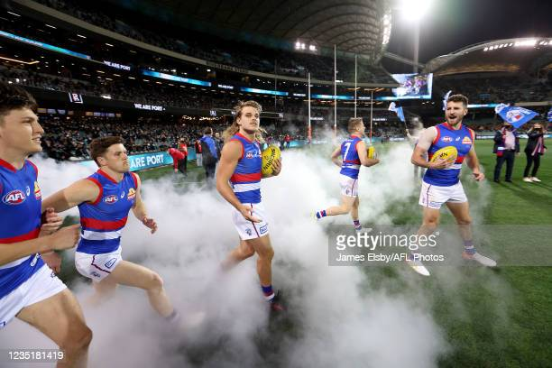 Marcus Bontempelli of the Bulldogs leads his team out during the 2021 AFL Second Preliminary Final match between the Port Adelaide Power and the...