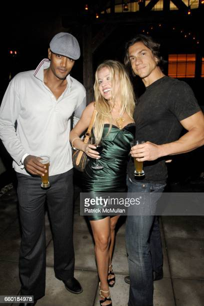 Marcus Borga Anna Kulinova and Vincent Maggio attend BOSS ORANGE New Direction Party at 601 West 26th street on July 23 2009 in New York City