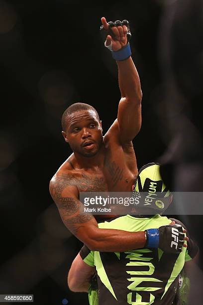 Marcus Brimage Jumabieke celebrates victory over Tuerxun in their bantamweight fight during the UFC Fight Night 55 event at Allphones Arena on...