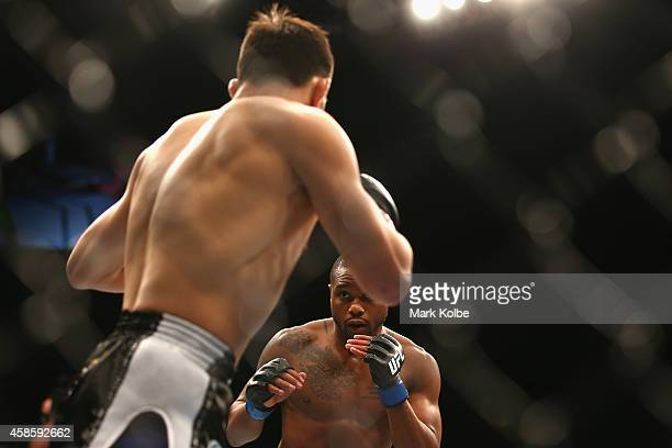 Marcus Brimage shapes up to Jumabieke Tuerxun in their bantamweight fight during the UFC Fight Night 55 event at Allphones Arena on November 8 2014...