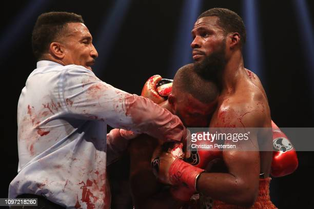 Marcus Browne and Badou Jack are seperated by referee Tony Weeks during the WBA interim WBC silver light heavyweight championship at MGM Grand Garden...