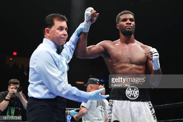 Marcus Browne gets his hand raised by referee Benjy Esteves after defeating Lenin Castillo by unanimous decision at the Nassau Veterans Memorial...