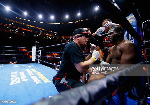 Marcus Browne is worked on in the corner between rounds against Cornelius White during their cruiserweight bout at Barclays Center of Brooklyn on May...