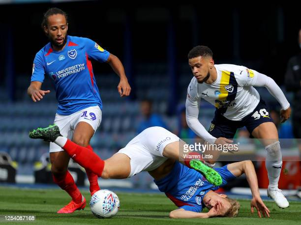 Marcus Browne of Oxford United is challenged by Cameron McGeehan of Portsmouth and Ross McCrorie of Portsmouth during the Sky Bet League One Play Off...