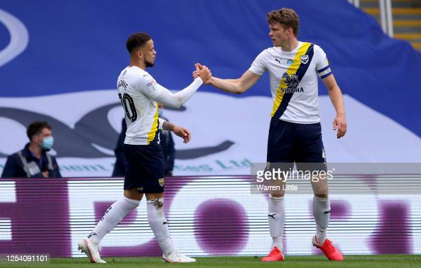 Marcus Browne of Oxford United is congratulated after he scores his teams first goal during the Sky Bet League One Play Off Semifinal 1st Leg match...