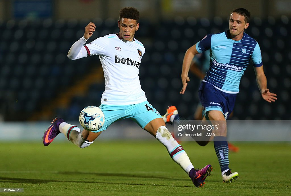 Marcus Browne of West Ham and Stephen McGinn of Wycombe Wanderers during the Checkatrade trophy match between Wycombe Wanderers and West Ham United at Adams Park on October 4, 2016 in High Wycombe, England.
