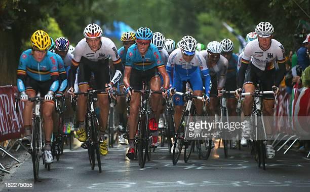 Marcus Burghardt Johan Vansummeren of Belgium and Fabian Wegmann of Germany in action during the Elite Men's Road Race a 272km race from Lucca to...