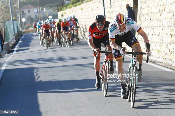 Marcus Burghardt of Germany and Team BoraHansgrohe / JeanPierre Drucker of Luxembourg and BMC Racing Team / attack on the Poggio Di Sanremo 160m...