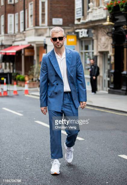 Marcus Butler is seen wearing blue suit outside St James's during London Fashion Week Men's June 2019 on June 08 2019 in London England