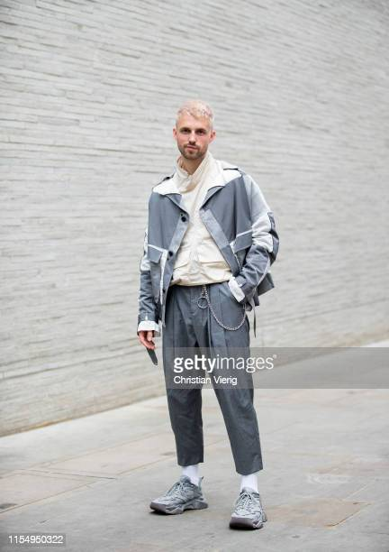 Marcus Butler is seen wearing grey jacket and pants outside Chalayan during London Fashion Week Men's June 2019 on June 09, 2019 in London, England.
