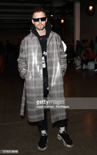 Marcus Butler on the front row during the Christopher Raeburn at London Fashion Week Men's AW19 show held at the BFC Show Space London