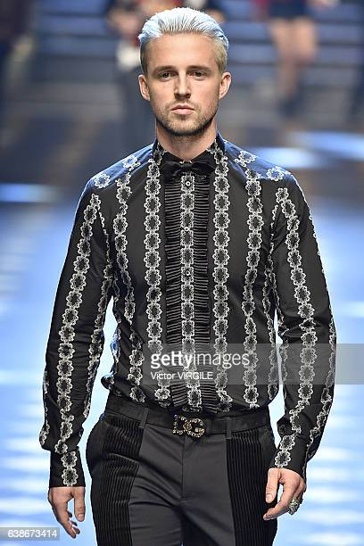 Marcus Butler walks the runway at the Dolce Gabbana show during Milan Men's Fashion Week Fall/Winter 2017/18 on January 14 2017 in Milan Italy