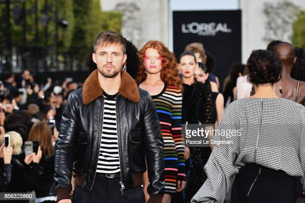 Marcus Butler walks the runway during Le Defile L'Oreal Paris as part of Paris Fashion Week Womenswear Spring/Summer 2018 at Avenue Des Champs...