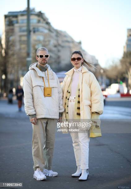 Marcus Butler wearing Jacquemus bag, Gucci shades and Nike sneaker and Stefanie Giesinger before Amiri on January 16, 2020 in Paris, France.
