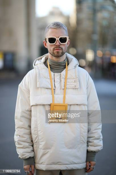Marcus Butler wearing Jacquemus bag, Gucci shades and Nike sneaker before Amiri on January 16, 2020 in Paris, France.