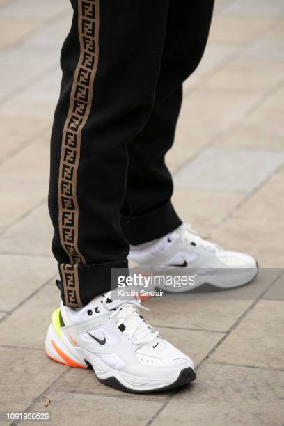 Marcus Butler wears Fendi trousers and Nike trainers during London Fashion Week Men's January 2019 on January 07 2019 in London England