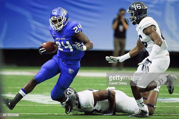 Marcus Caffey of the Georgia State Panthers runs the ball past Antwione Williams and Antonio Glover of the Georgia Southern Eagles in the first half...