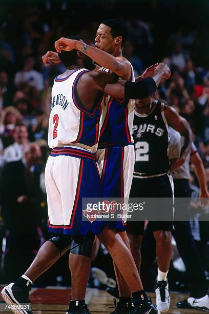 Marcus Camby and Larry Johnson of the New York Knicks chest bump during Game Three of the 1999 NBA Finals played on June 21 1999 at Madison Square...