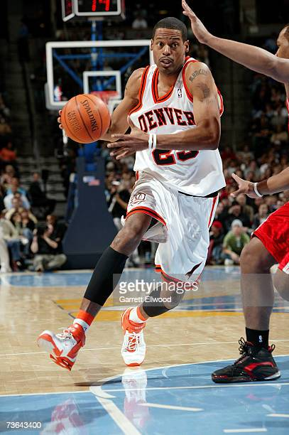 Marcus Camby of the Denver Nuggets drives down the lane against the Houston Rockets at Pepsi Center on March 2 2007 in Denver Colorado The Rockets...