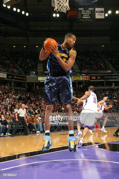 Marcus Camby of the Denver Nuggets grabs the rebound against the Sacramento Kings on February 3 2007 at ARCO Arena in Sacramento California NOTE TO...