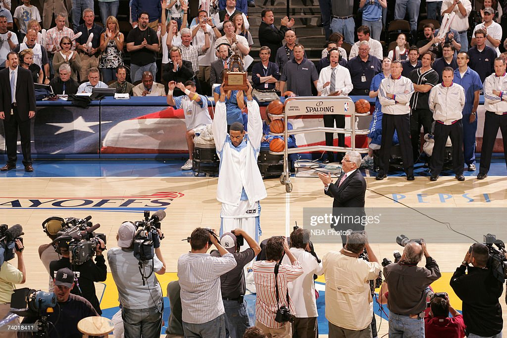 Marcus Camby #23 of the Denver Nuggets is presented with the defensive player of the year trophy before the game against the San Antonio Spurs in Game Three of the Western Conference Quarterfinals during the 2007 NBA Playoffs at Pepsi Center April 28, 2007 in Denver, Colorado.