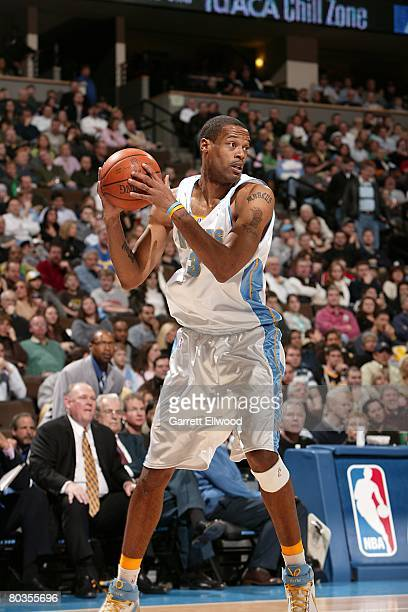Marcus Camby of the Denver Nuggets moves the ball during the NBA game against the Washington Wizards on February 8 2008 at the Pepsi Center in Denver...