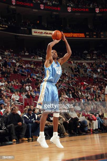 Marcus Camby of the Denver Nuggets shoots a jumper during the game against the Philadelphia 76ers at the Wachovia Center on December 12 2003 in...