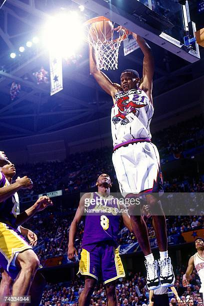 Marcus Camby of the Eastern Conference attempts a dunk against Kobe Bryant of the Western Conference during the 1997 Rookie Game played February 8...