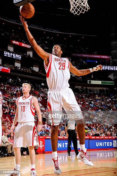 Marcus Camby of the Houston Rockets goes for a rebound against the Indiana Pacers on April 1 2012 at the Toyota Center in Houston Texas NOTE TO USER...