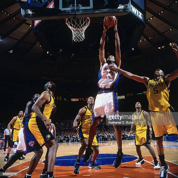 Marcus Camby of the New York Knicks grabs a rebound against Jalen Rose of the Indiana Pacers in Game Three of the Eastern Conference Finals during...