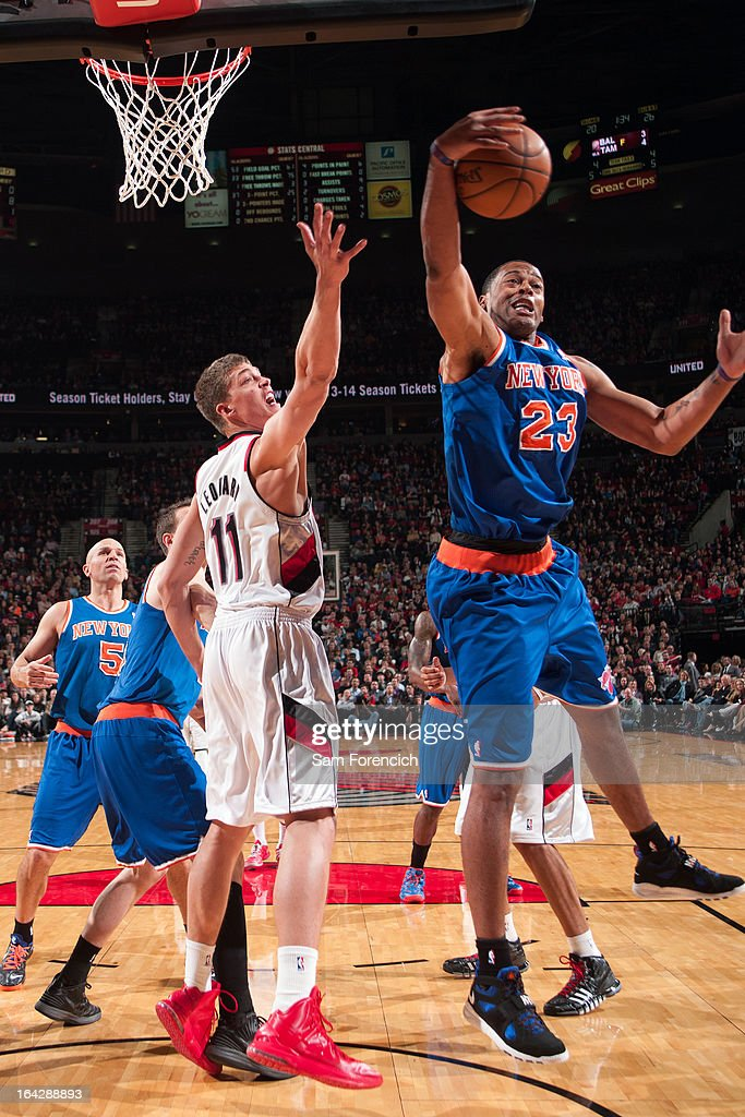 Marcus Camby #23 of the New York Knicks grabs a rebound against the Portland Trail Blazers on March 14, 2013 at the Rose Garden Arena in Portland, Oregon.