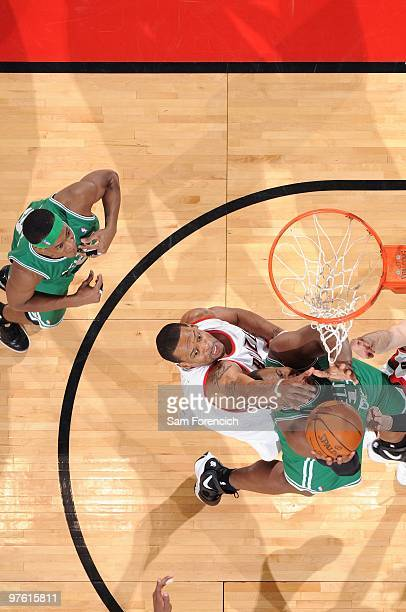 Marcus Camby of the Portland Trail Blazers blocks a shot by Glen Davis of the Boston Celtics during the game at The Rose Garden on February 19 2010...