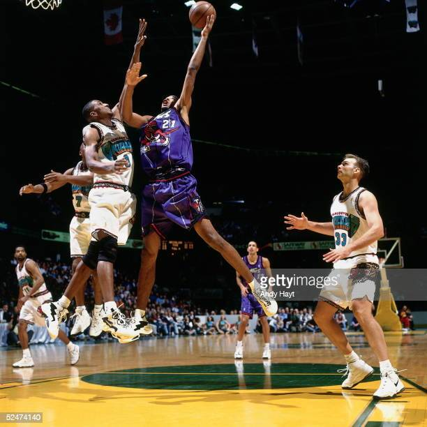 Marcus Camby of the Toronto Raptors drives to the basket for a shot against the Vancouver Grizzlies on October 27 1996 during an NBA game in Calgary...