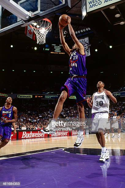 Marcus Camby of the Toronto Raptors dunks during a game played on March 3 1997 at Arco Arena in Sacramento California NOTE TO USER User expressly...