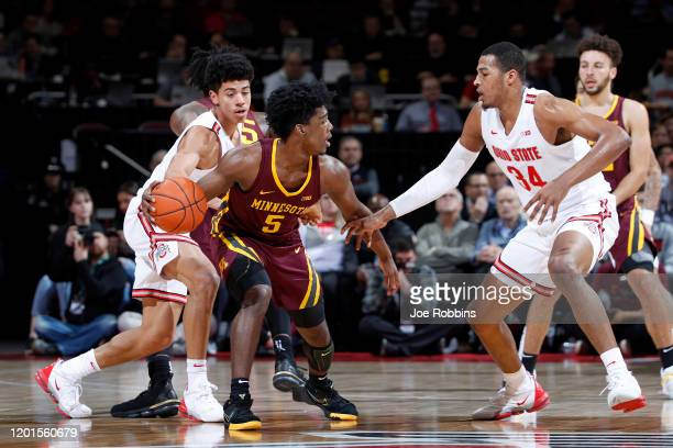 Marcus Carr of the Minnesota Golden Gophers handles the ball against DJ Carton and Kaleb Wesson of the Ohio State Buckeyes in the first half of the...