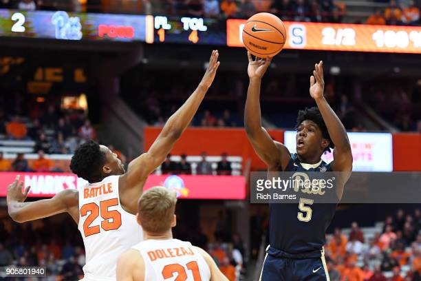 Marcus Carr of the Pittsburgh Panthers shoots the ball against the defense of Tyus Battle of the Syracuse Orange during the first half at the Carrier...