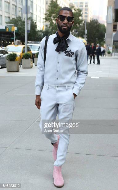 Marcus Carrol weraing an OSNYC jumper and Top Shop boots poses in the Spring/Summer 2018 womenswear collection shows during New York Fashion Week at...