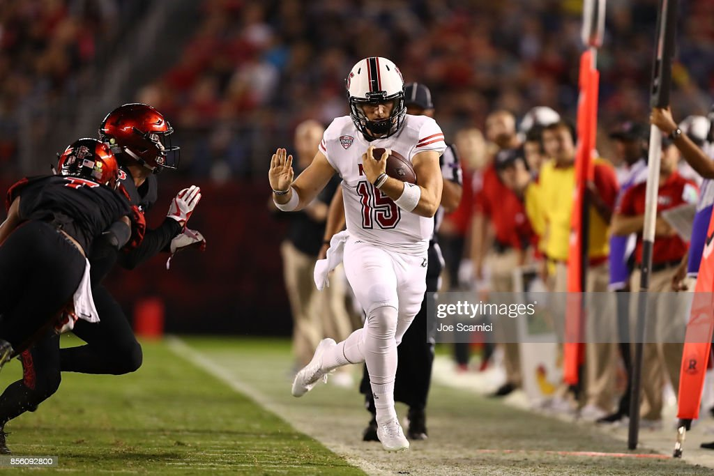 Marcus Childers #15 of the Northern Illinois Huskies runs the ball out of bounds in the first quarter during the Northern Illinois v San Diego State game at Qualcomm Stadium on September 30, 2017 in San Diego, California.