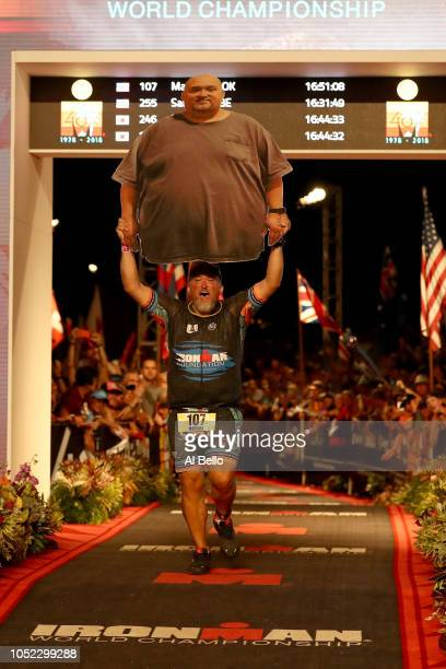 Marcus Cook of the United States finishes the IRONMAN World Championships brought to you by Amazon on October 13 2018 in Kailua Kona Hawaii