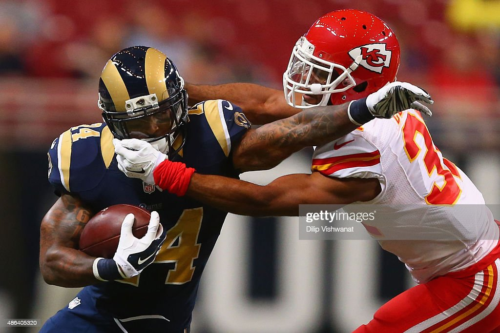 Marcus Cooper #31 of the Kansas City Chiefs tackles Isaiah Pead #24 of the St. Louis Rams in the first quarter during a pre-season game at the Edward Jones Dome on September 3, 2014 in St. Louis, Missouri.