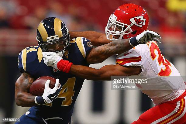 Marcus Cooper of the Kansas City Chiefs tackles Isaiah Pead of the St Louis Rams in the first quarter during a preseason game at the Edward Jones...